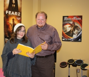 VGaD student Samantha Bruce shows some of her artwork to SEGA exec Ethan Einhorn during his recent visit to the college.