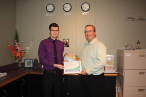 Second-year student Kieran Atkinson accepts his eMerit certificate from Rod Clark, eMerit coordinator for TIAPEI.