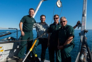 Crew shot after the discovery of the Franklin wreck (Jonathan Moore, Ryan Harris, Joe Boucher, Chriss Ludin) at the stern of RV Investigator. Photo by Thierry Boyer