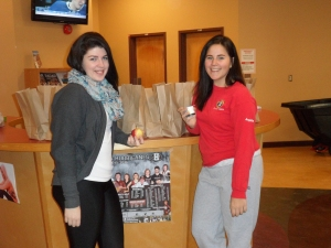 Business student Amanda Myers, left, and Sport and Leisure student Angelle LeBlanc prepare the breakfast bags for students to pick up.