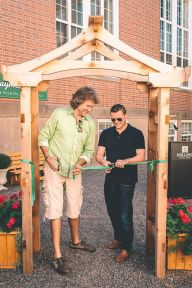 Chef Micheal Smith, left, and Chef Adam Loo, son of Raymond Loo, at the grand opening of the garden.