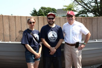 Holland College Heritage Retrofit Carpentry graduates Kelly Caseley and Logan Bonneville with HC vice president Mike O'Grady at the Ice Boat Monument in Cape Traverse